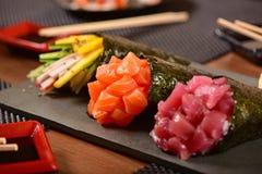 Tre sushi di temaki Fotografia Stock