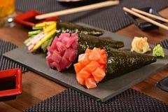 Tre sushi di temaki Fotografie Stock Libere da Diritti