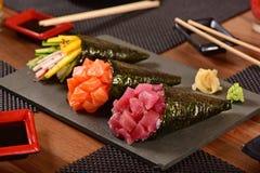 Tre sushi di temaki Immagini Stock Libere da Diritti