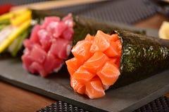 Tre sushi di temaki Immagine Stock
