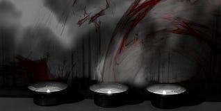 Tre tända stearinljus som står mot en colorsplashvägg/bakgrund arkivfoto