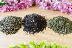 Tre tè trovati su una tavola Immagine Stock