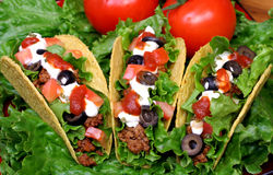 Tre tacos riempiti Fotografie Stock
