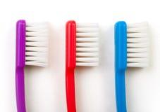 tre tandborstar Fotografering för Bildbyråer