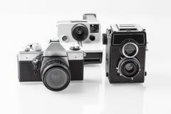 Tre tappninganalogkameror Arkivbilder
