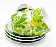 Tre tazze con i piattini isolati Immagine Stock