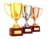 Tre tazze del trofeo in una fila Fotografia Stock Libera da Diritti
