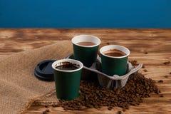 Tre tazze di caffè del cartone Immagini Stock
