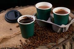 Tre tazze di caffè del cartone Immagine Stock
