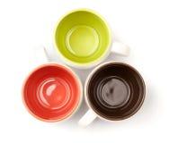 Tre tazze di caffè di colore immagine stock
