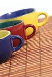 Tre tazze di d Immagine Stock