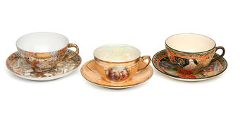 Tre tazze di tè cinesi sopra bianco Fotografie Stock