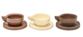 Tre tazze e piattini di caffè fatti di cioccolato Immagine Stock Libera da Diritti