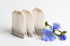 Tre tepåsar med cikorien Fotografering för Bildbyråer