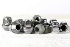 Tre tipi di dadi della ruota fotografie stock