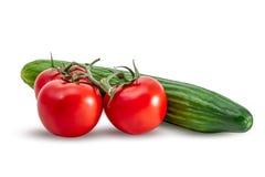 Tre tomater och gurka Royaltyfri Foto