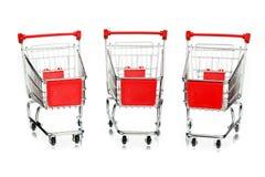 Tre tomma shoppingvagnar Arkivfoton