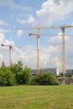 Tre tornkranar på konstruktionsplats Arkivbild