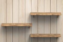 Tre trähyllor på väggen Arkivfoton