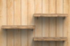 Tre trähyllor på väggen Fotografering för Bildbyråer