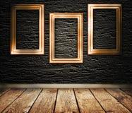 Tre träramar på en vägg stock illustrationer