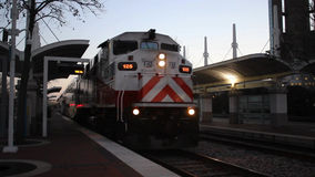 TRE Train leaving Central Station. Trinity Railway Express train leaving Central Station in Downtown Dallas on a winter evening, with sound stock footage