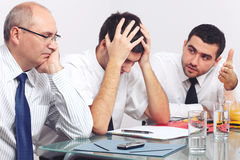 Tre tristi ed uomo d'affari depresso Fotografie Stock Libere da Diritti