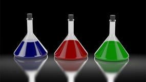 Tre tubi di chimica con differenti colori di liquido Fotografia Stock Libera da Diritti
