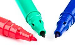 Tre tuschpennor med primära RGB-färger Arkivbilder