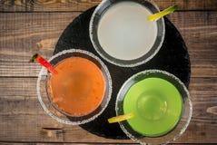 Tre typer av alkoholiserade coctailar med martini Arkivfoton