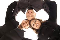 Tre unga affärspersoner i formell kläder Royaltyfri Bild