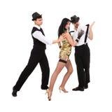 Tre unga gammalmodiga dansare Arkivbilder