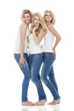 tre unga kvinnor Arkivfoto