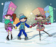 Tre ungar på den åka skridskor isbanan Royaltyfria Foton