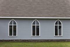 Tre unicamente a forma di finestre in una fila fotografie stock libere da diritti