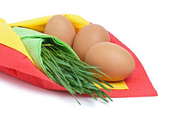 Tre uova con erba verde Fotografia Stock Libera da Diritti