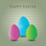 Tre uova di Pasqua variopinte nella priorità bassa a strisce Fotografia Stock
