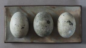 Tre uova di secolo in un piccolo piatto fotografia stock