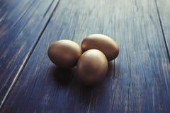 Tre uova dorate Immagini Stock