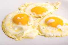Tre uova fritte Immagini Stock Libere da Diritti