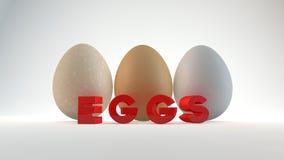 Tre uova isolate su fondo bianco. Fotografia Stock Libera da Diritti