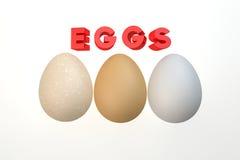 Tre uova isolate sul bianco Fotografie Stock