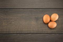 Tre uova marroni con precisione illuminate Fotografia Stock Libera da Diritti