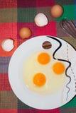 Tre uova nel piatto Fotografia Stock