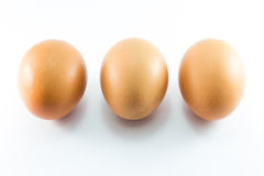 Tre uova su priorità bassa bianca Fotografie Stock