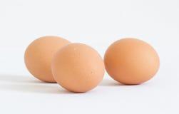 Tre uova su priorità bassa bianca Fotografia Stock Libera da Diritti