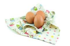 Tre uova sul bello panno Fotografia Stock Libera da Diritti