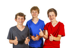 Tre vänner som gör thumbs-up och som-den-tecknet Arkivbild