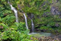Tre vattenfall i en tropisk skog Arkivbild