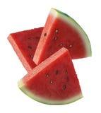 Tre vattenmelonskivor på vit bakgrund Fotografering för Bildbyråer
